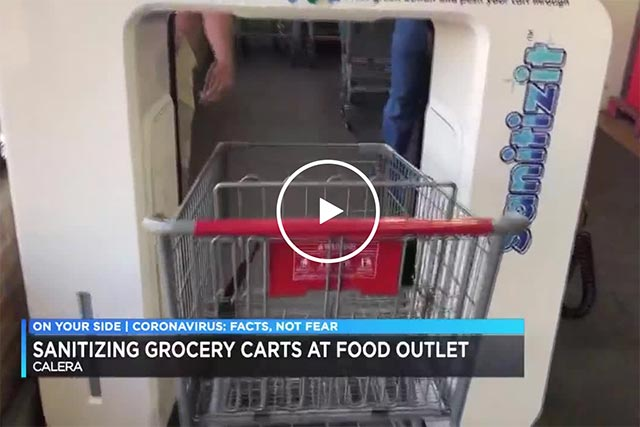 Sanitizing grocery carts at food outlet